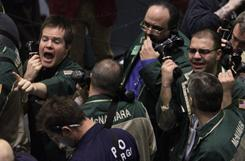 Traders work the crude oil options pit at the New York Mercantile Exchange Tuesday, Feb. 22, 2011 in New York.