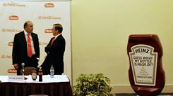 CEOs Muhtar Kent, left, of Coca-Cola and William Johnson of H.J. Heinz chat before announcing that Coca-Cola will let Heinz use its eco-friendly packing technology.