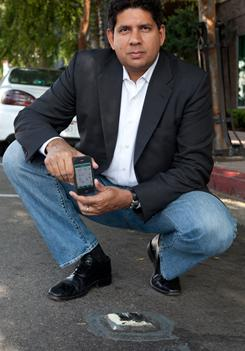 Streetline, with CEO Zia Yusuf, installs battery-powered sensors in parking spaces in the Hollywood district of Los Angeles.