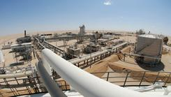 Production facilities of the German oil firm Wintershall near the Oasis of Jakhira in the Libyan desert.