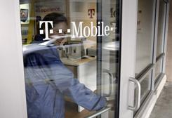 A customer walks out of a T-Mobile store in Palo Alto, Calif., Friday, Feb. 25, 2011.
