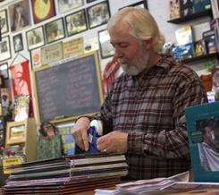 Tim Cretsinger prices an order of new vinyl records at his Cedar City, Utah, store, Groovacious.