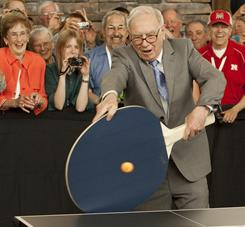 Berkshire Hathaway CEO Warren Buffett uses a super large paddle to play table tennis against junior champ Ariel Hsing in Omaha on Oct. 5, 2010.