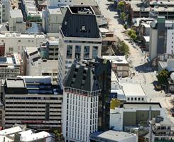 The 26-story Grand Chancellor Hotel tower, center back, in Christchurch, New Zealand, leans to the right, prompting fears it could collapse.
