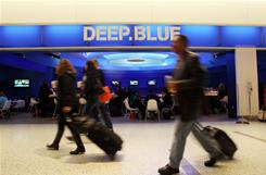 Travelers pass by Deep Blue Sushi in the JetBlue terminal at New York's JFK airport. Deep Blue Sushi is a top airport restaurant pick.