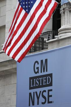 A banner displaying the name of General Motors covers the New York Stock Exchange on Nov. 18, 2010, the first day of trading for the new General Motors stock.