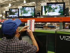 A shopper notes television prices at the Costco Wholesale store on Feb. 28, 2011, in Glendale, Calif.