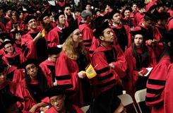 Harvard University students attend 2009 commencement ceremonies in Harvard Yard in Cambridge, Mass.