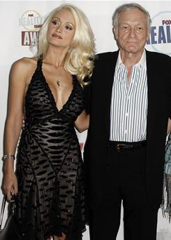 Holly Madison, left, and Hugh Hefner arrive at the Fox Reality Channel Really Awards in Los Angeles in 2008.