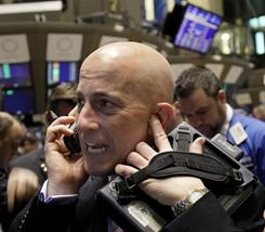 Trader Richard Jenna works on the floor of the New York Stock Exchange.