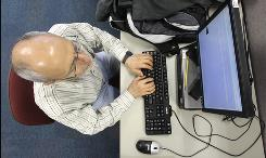 An unemployed man looks for a job at WorkSource Oregon on Jan. 7 in Tualatin, Ore.