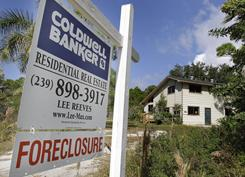 A foreclosed home is shown on Pine Island in Lee County, Fla.