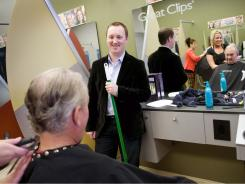 Franchise owner Brian Stevens, center, chats with his father and business partner, Pat Stevens, as Pat gets his hair cut by stylist Kelly Klabecheck on Friday at the Great Clips Hair Salon in Plymouth, Minn.