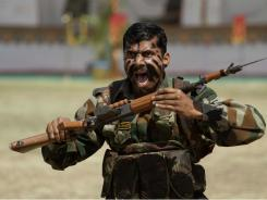 """An Indian army soldier displays his skills during a """"Know Your Army"""" exhibition in Ahmadabad, India on March 14, 2011."""