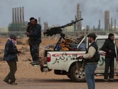 Rebels fighting Moammar Gadhafi and troops loyal to the Libyan leader have engaged in fighting in the oil town of Ras Lanuf.