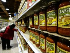 A woman shops at Wegmans Foods store in Fairfax, Va., on Feb. 24, 2011 Some are worried about food prices.
