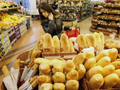 A customer browses for bread at a store in Belgrade, Serbia, on  March 7.