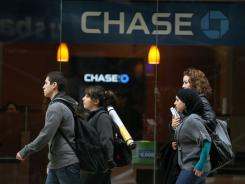 JPMorgan Chase said it is increasing its dividend to 25 cents a share from 5 cents.