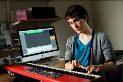 James Merryman makes music with his iPad's GarageBand application.