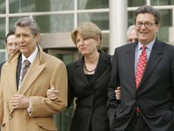 Former Qwest CEO Joe Nacchio, in dark suit, his wife Anne and his then-attorney Herbert Stern leave the federal courthouse in Denver in 2007.