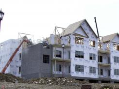 Construction continues Feb. 17, 2011, on a row of condominiums in Cranberry, Pa.,