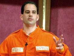 Barry Minkow gives a sermon on materialism at the Community Bible Church in San Diego while wearing his prison jump suit Sunday, July 7, 2002.