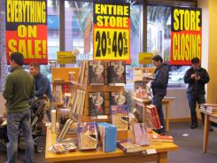 In this Feb. 20, 2011 photo, customers look for books during a liquidation sale at a Borders book store in San Jose, Calif.