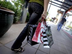 A shopper walks through the outdoor San Tan Village Mall on March 28, 2011 in Gilbert, Ariz.