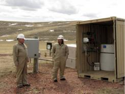 Roland DeBruyn, left,  vice president of engineering for Luca Technologies, and the company's vice president of operations, Verlin Dannar, at a coal-bed methane well near Gillette, Wyo.