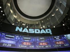 The Nasdaq MarketSite in New York, showing major stock indexes.
