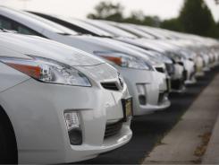 Toyota Prius sedans at a suburban Denver dealership in 2010.