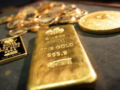 In A one kilo gold bar on display along with a 1621 Sigismund III Gold 100 Ducat coin at Stack's Rare Coins in New York.