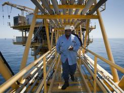 King Pleasant, front, and Derek Davis during their daily inspection of oil platform ST 204, in the Gulf of Mexico.