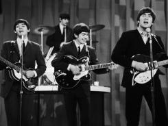 "In this Feb. 9, 1964 file photo, The Beatles perform on the ""Ed Sullivan Show"" in New York."