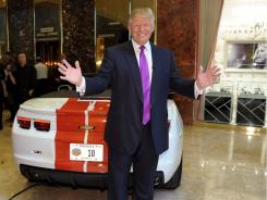 Donald Trump checks out his new ride -- the 2011 Indianapolis 500 Chevrolet Camaro SS Convertible Pace Car at Trump Tower on April 5, 2011 in New York.