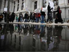 Protesters facing foreclosure and their advocates march March 24, 2011, outside City Hall in Philadelphia.