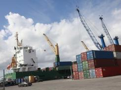 In this Feb. 4, 2011 photo, shipping containers are shown next to the cargo ship Westerhaven docked at the Port of Miami.