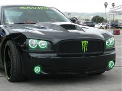 """This black Charger was given green """"halo lights"""" to make it stand out while sitting still."""