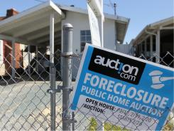 A foreclosure sign on a distressed home in Richmond, Calif.