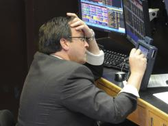A trader works on the floor of the New York Stock Exchange on April 18, 2011.