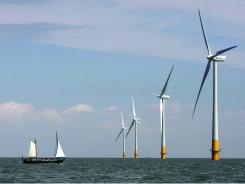 In this July 11, 2006 file photo, a boat sails toward a wind farm off the coast of Whitstable on the north Kent coast in southeastern England.