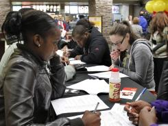 Job seekers fill out applications before being interviewed at a downtown Pittsburgh McDonald's restaurant Tuesday, April 19, 2011.