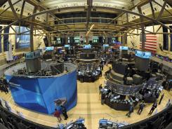 A trading post, left, is modernized on the floor of the New York Stock Exchange, Monday, April  18, 2011, in New York.