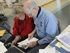 AARP volunteer Gary Smith, 74, helps Dorothy Budzynski, 82, with her 2010 tax return in Annandale, Va.