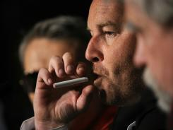 "French director Xavier Beauvois smokes an electronic cigarette during a press conference for  ""Des Hommes et des Dieux"" (Of God and Men) in this 2010 file photo."