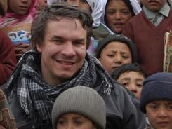 Author Greg Mortenson in 2006 with school children in Hushe Valley in Pakistan.