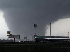 A tornado rips through Tuscaloosa, Ala., on Wednesday.