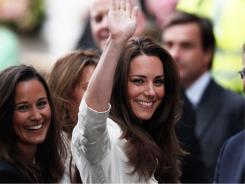 Kate Middleton waves to fans in London a day before the big royal wedding.