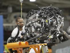 An assemblyman works in April on an engine for the Chrysler Jeep or the Dodge Durango, which are built on the same line at Chrysler's Jefferson North Assembly Plant in Detroit.