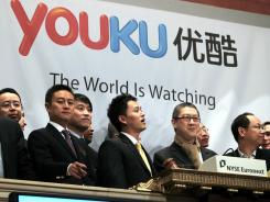 Youku.com executives ring the bell of the New York Stock Exchange after the Chinese company went public December 8, 2010.